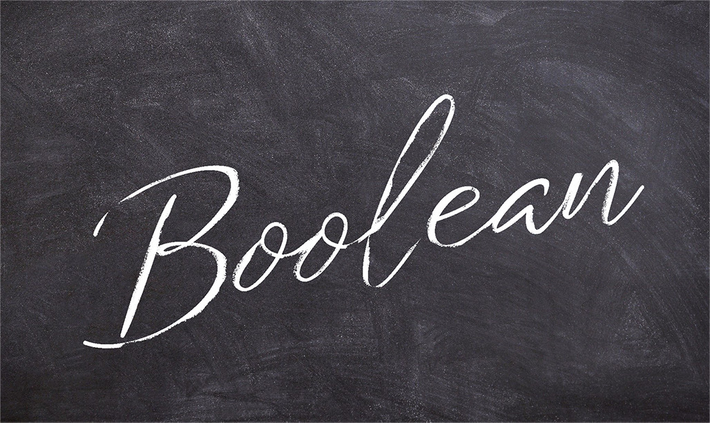 "Image of a black board with the word ""Boolean"""