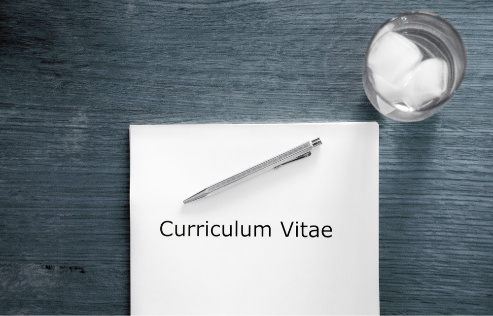 Photo of a desk with a curriculum vitae in the context of an interview